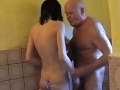 Young dark brown hair helps older man take a shower and dries his cock with her throat