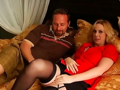 Arousing golden haired milf gets her large marangos touched by a naughty and turned on lad