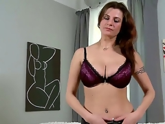 Lengthy haired handsome brunette hair milf Angie in sexy underclothes gets naked on living room and reveals her huge breathtaking hooters and awesome tattoos in arousing teasing session