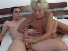 Agw wrinkled golden-haired Malya is naked and willing for sex with young hard dicked guy. That babe gives headjob and then takes his meat pole up her loose experienced pussy. See older floozy bounce on hard dick