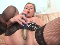 Lean mature honey in dark fishnets masturbates