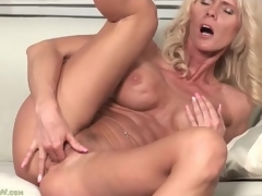 Fit golden-haired older with big titties fingers box