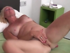 Sexy solo golden-haired mature masturbates box
