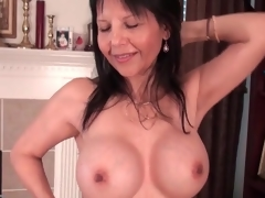 Hot mature fondles her large fake tits lustily