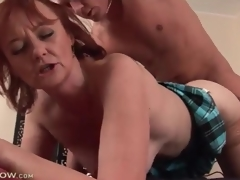 Mature redhead fucked in her sexy cunt