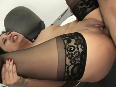Lying on her back, she spreads her pantyhosed legs relishing his dong unfathomable in her vagina