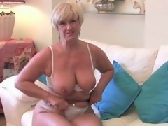 Blond granny plays with the brush muff