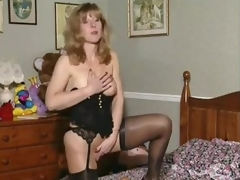 Slutty British milf in her solo scene